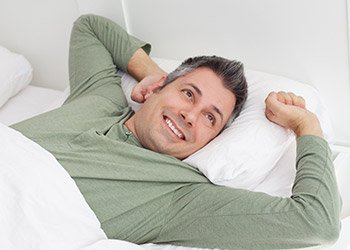 Man waking feeling refreshed